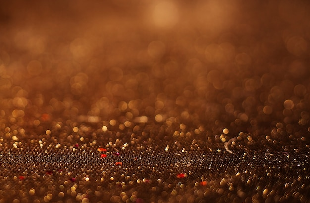 Gouden feestelijke kerst achtergrond. elegante abstracte achtergrond met bokeh intreepupil lichten en sterren.