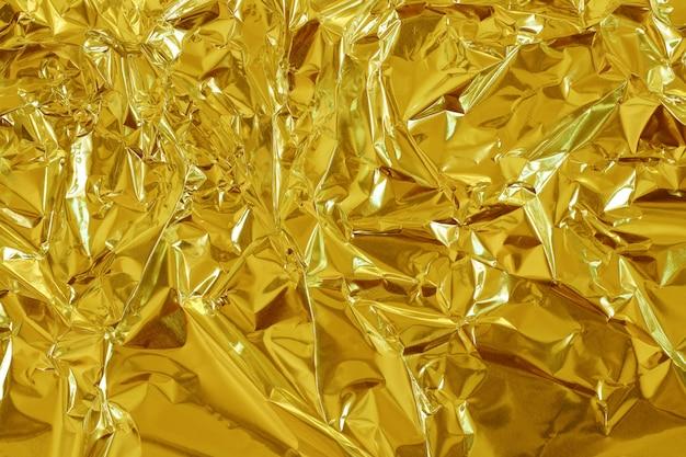 Gouden folie glanzende textuur achtergrond