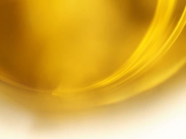 Gouden gele kromme abstracte achtergrond