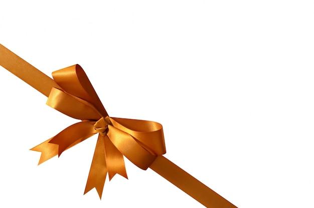 Gouden geschenk boeg en lint op wit wordt geïsoleerd