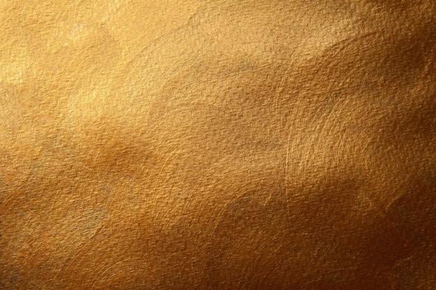 Gouden geschilderde textuurachtergrond. decoratief oppervlak.