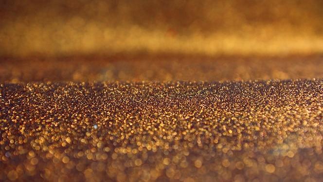 Gouden glitter bokeh lichten achtergrond
