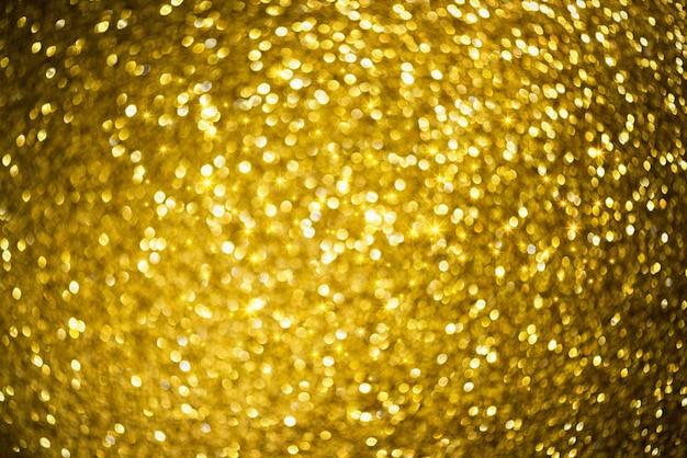 Gouden glitter bokeh verlichting textuur wazig abstracte achtergrond