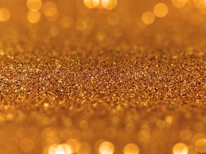 Gouden glitter defocused bokeh achtergrond