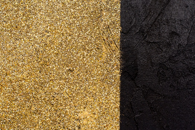 Gouden glitter met leisteen achtergrond concept
