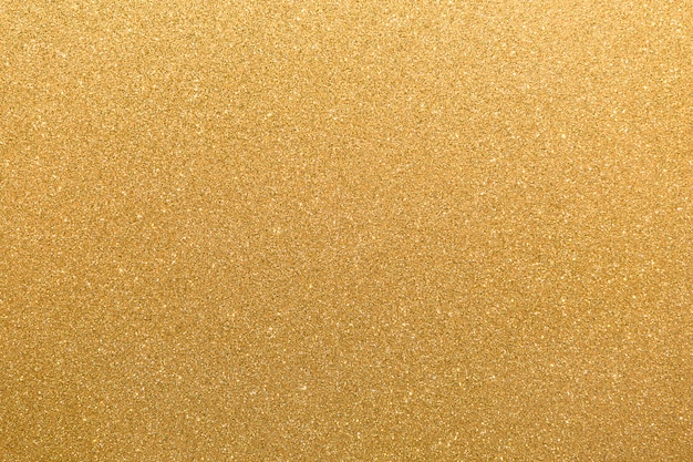 Gouden glitter oranjegeel oppervlak met knipperende witte onregelmatige vlekken achtergrond.