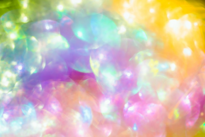 Gouden glitter textuur colorfull wazig abstracte achtergrond voor verjaardag nieuwe jaar vooravond of kerstmis