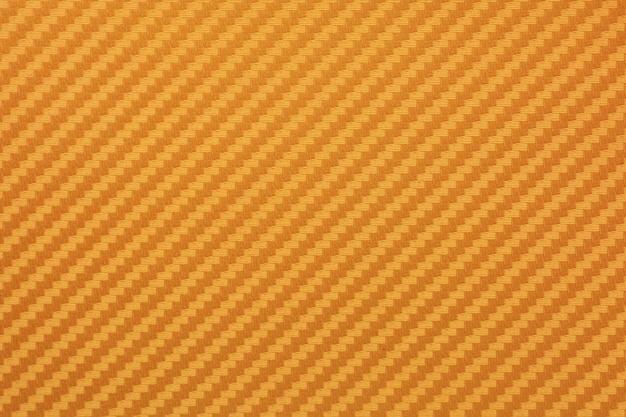 Gouden koolstofvezel composiet grondstof achtergrond