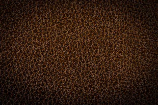 Gouden lederen abstracte textuur achtergrond. donkere toon