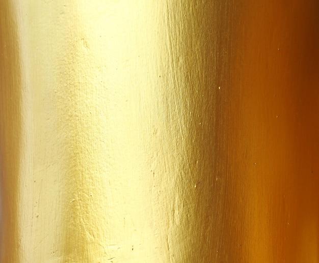 Gouden muur abstracte achtergrond en textuur.