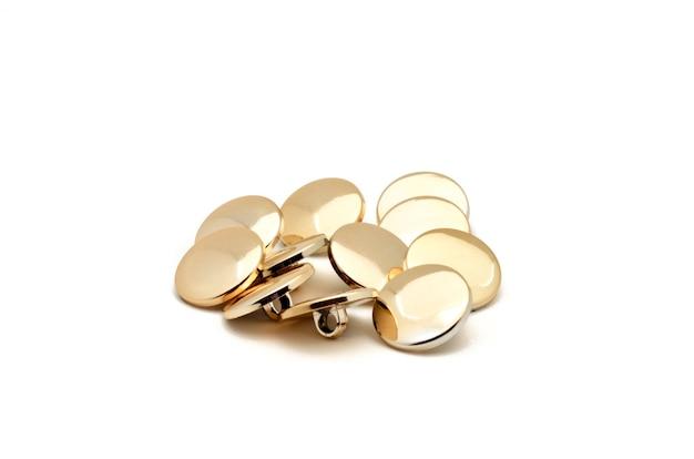 Gouden naaiende knopen