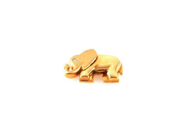 Gouden olifant met diamanten geïsoleerd op een witte achtergrond