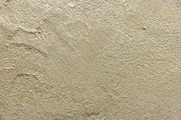 Gouden rommelig muur stucwerk textuur. close-up decoratieve gipsverf voor achtergrond.