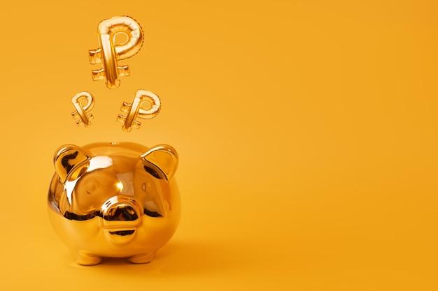 Gouden spaarvarken op gele achtergrond met gouden roebel teken ballonnen. russisch valutasymbool gemaakt van folieballon. investeringen en bankwezenconcept. geld besparen, spaarpot, financiën, investeringen.