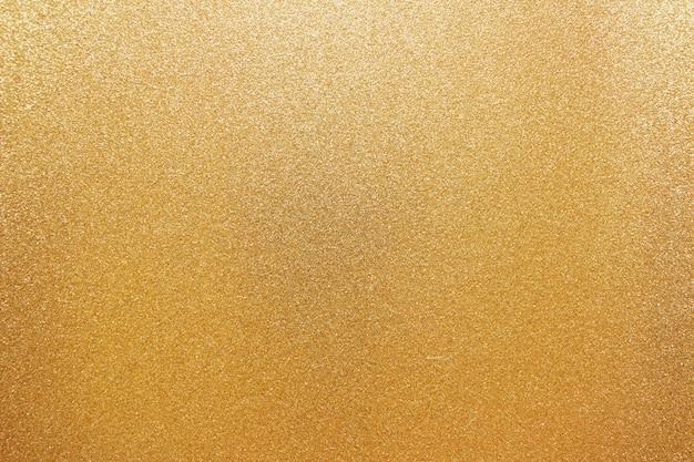 Gouden sprankelende achtergrondkleur feestelijke korrels