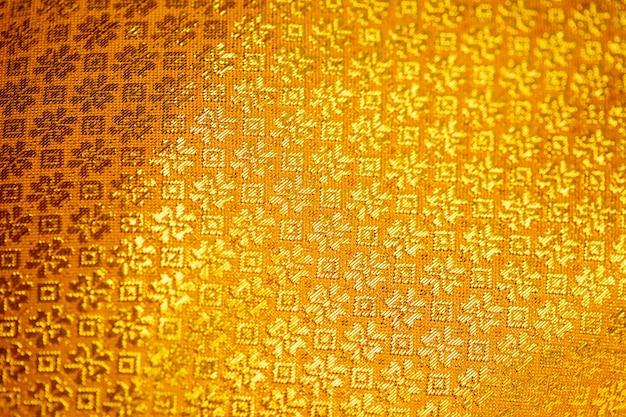 Gouden stof zijde textuur voor achtergrond