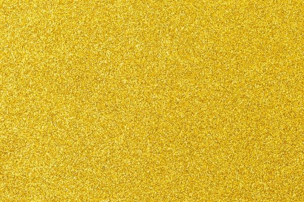 Gouden textuur voor ruimte, abstracte gouden glitter perfect voor kerstmis, nieuwjaar of een andere vakantieruimte