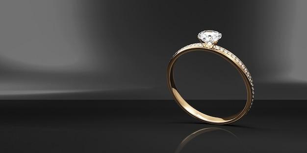 Gouden trouwring met diamanten op zwarte studioachtergrond