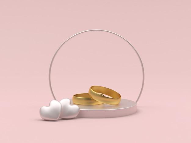 Gouden trouwringen en twee harten op een ronde standaard