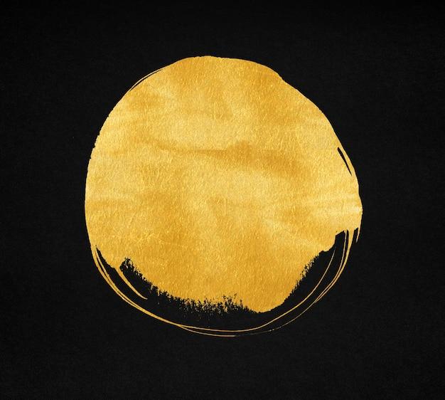 Gouden verfvlek op zwart papier achtergrond. gouden cirkel textuur.