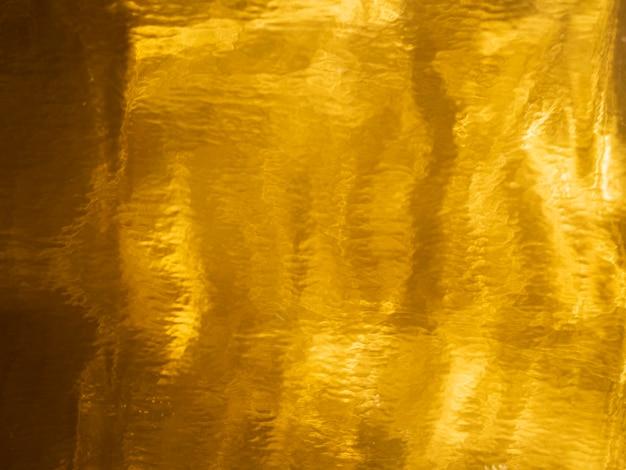 Gouden verzadigde textuurachtergrond