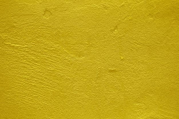 Goudgeel beton, cement textuur achtergrond.