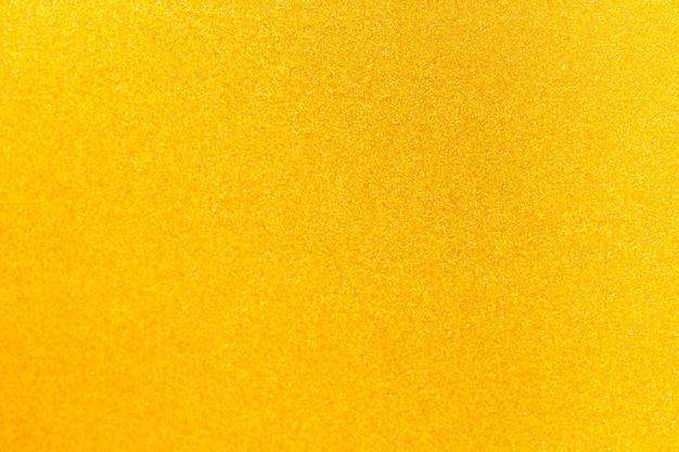 Goudgele glitter getextureerde glanzende achtergrond