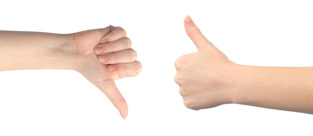 Graag en niet leuk handgebaar, jonge vrouwelijke hand close-up, geïsoleerd op een witte achtergrond photo