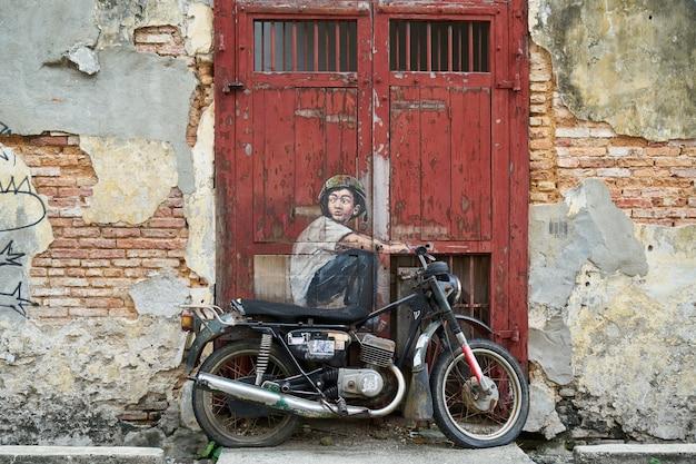 Graffiti van een man rijden op een motorfiets