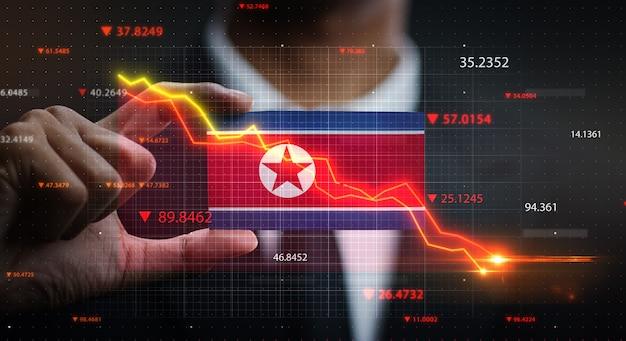 Grafiek vallen voor de vlag van noord-korea. crisis concept
