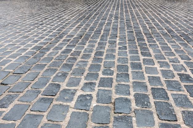 Graniet geplaveide stoep muur