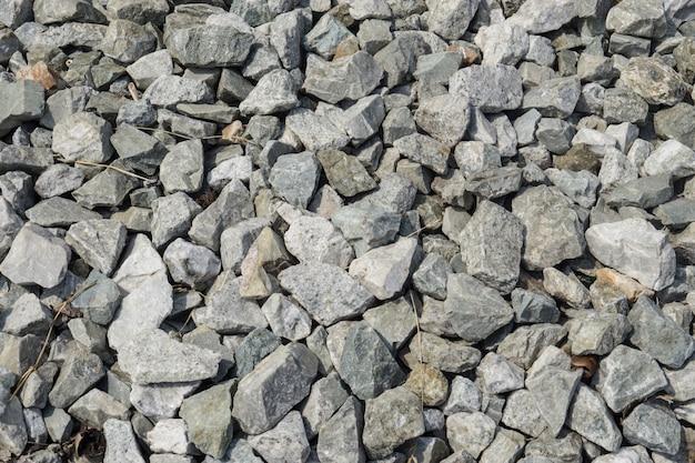 Graniet verpletterde steenachtergrond, rotstextuur.