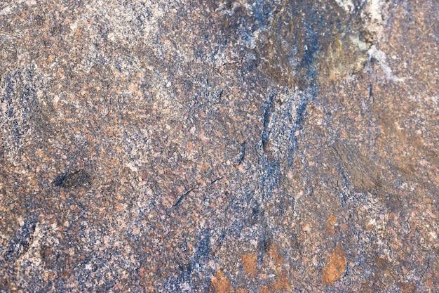 Granieten steen textuur muur, close-up van de steen
