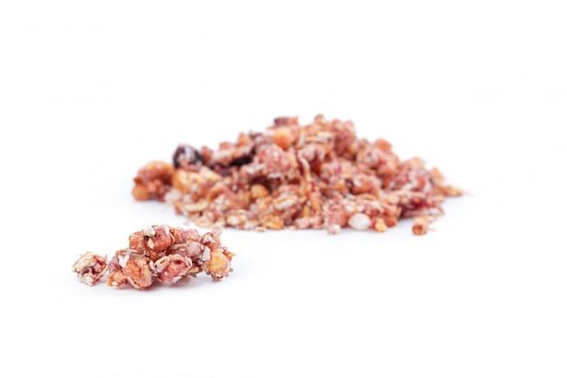 Granola gezond ontbijt dat op wit wordt geïsoleerd