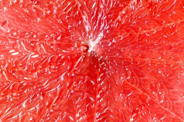 Grapefruit gesneden half op grijs. citrusvruchten macro. ruimte kopiëren, bovenaanzicht