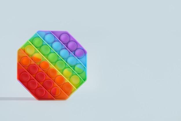 Grappige siliconen kleurrijke anti-stress pop it speelgoed op grijs