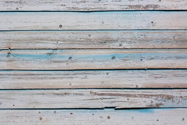Grijs en blauw gekleurd hout.