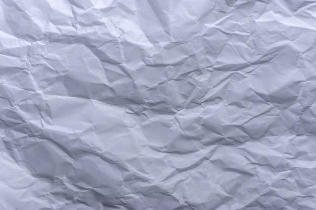 Grijs papier verfrommelen textuur achtergrond.