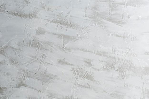 Grijs-witte concrete textuur als achtergrond met exemplaarruimte