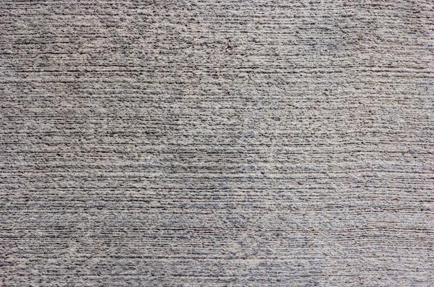 Grijs-witte ruwe abstracte stucwerk textuur voor achtergrond
