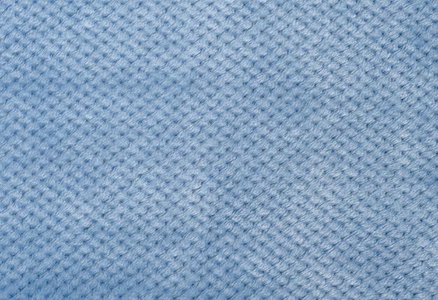 Grijsblauw pluche, stof voor het naaien van kleding, close-up