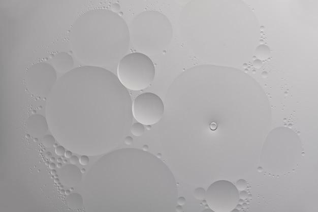 Grijze abstracte achtergrond olie bubble textuur behang