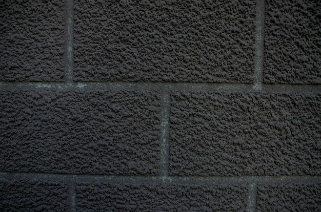 Grijze achtergrond een deel van een gipsen muur als achtergrond