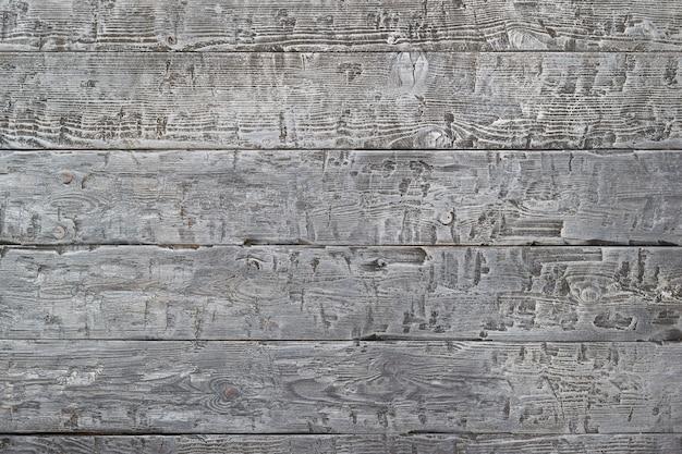Grijze achtergrond van houten planken met zwarte naden.