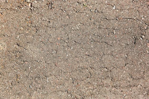 Grijze asfalt close-up textuur