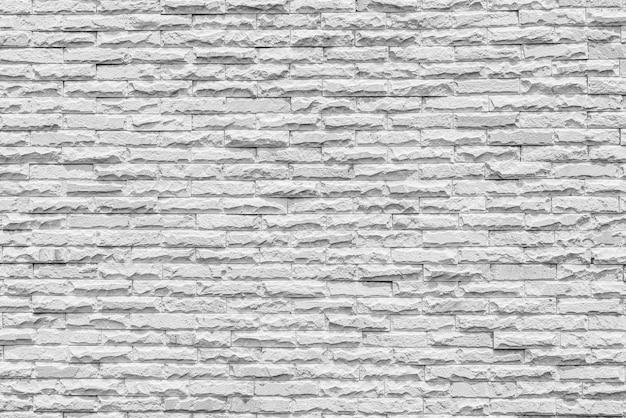 Grijze bakstenen muur achtergrond