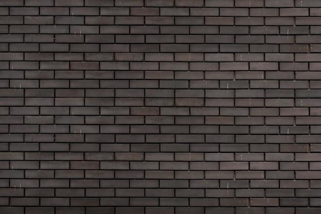 Grijze bakstenen muur getextureerde achtergrond