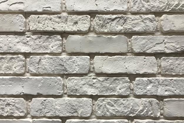 Grijze bakstenen muur textuur achtergrond. binnenlands ontwerpconcept met exemplaarruimte