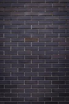 Grijze bakstenen muurachtergrond, textuur
