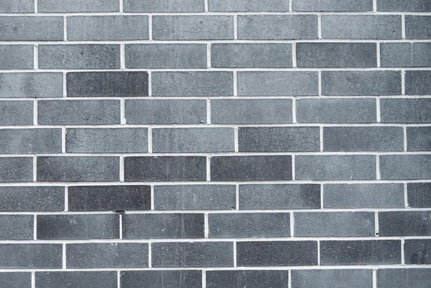 Grijze bakstenen muurachtergrond